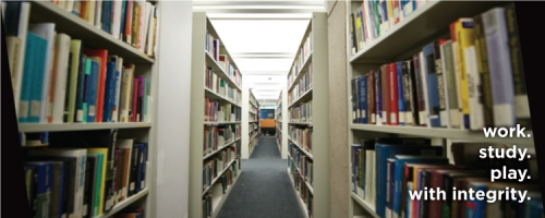 "Photo of library bookshelves with our ""work study play with integrity"" slogan"