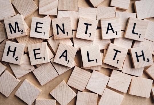 MENTAL HEALTH written in scrabble tiles