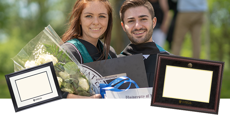 Two new alumni with diplomas