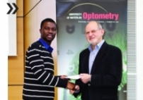 Image of Otchere receiving an inaugural Desmond Fonn Contact Lens Research Awards for outstanding research and academic achievement.