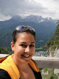 Laura wearing black and gold in Werfen, Austria, hiking through the Alps