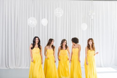 Girls in yellow bridesmaid dresses
