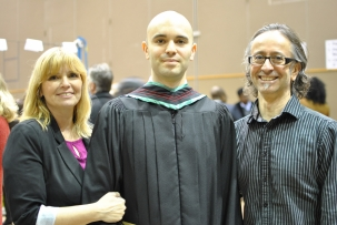 with his mom and dad at convocation