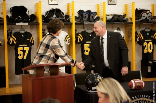 Coach in locker room