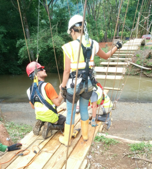 Alison and peer working to construct the bridge