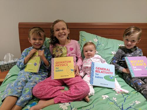Chris's kids with the books he has written