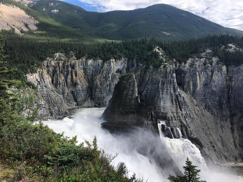 Learning from the land and its people at Virginia Falls (twice the height of Niagara Falls) in the Northwest Territories