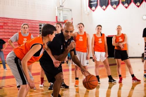 Mano teaching basketball
