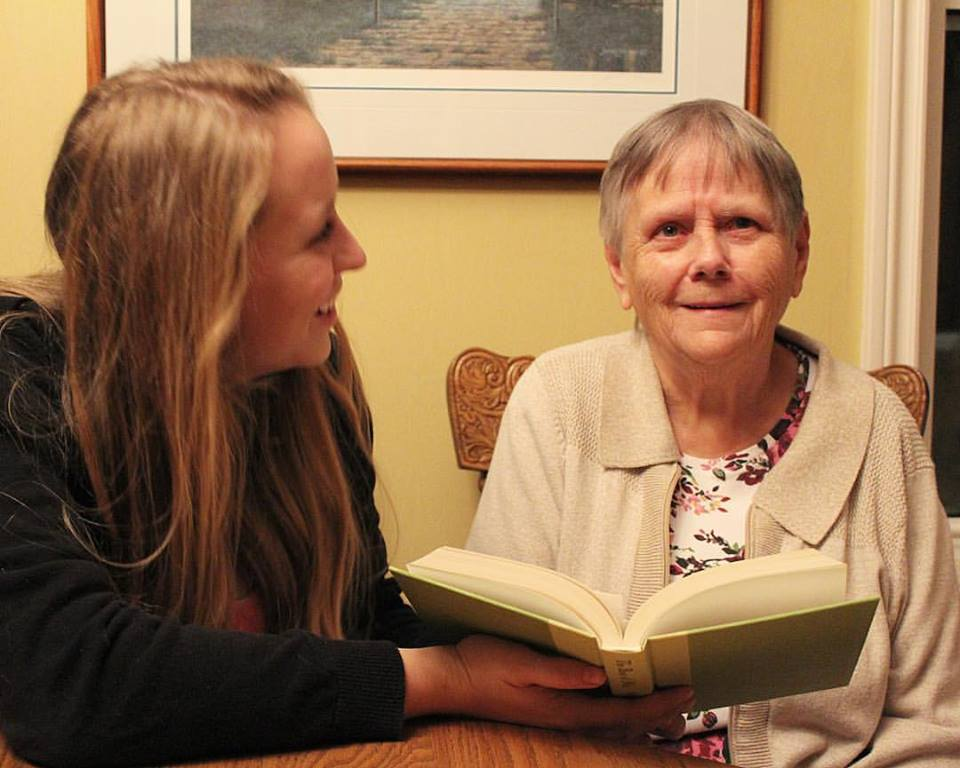 Rachael reading with her grandmother