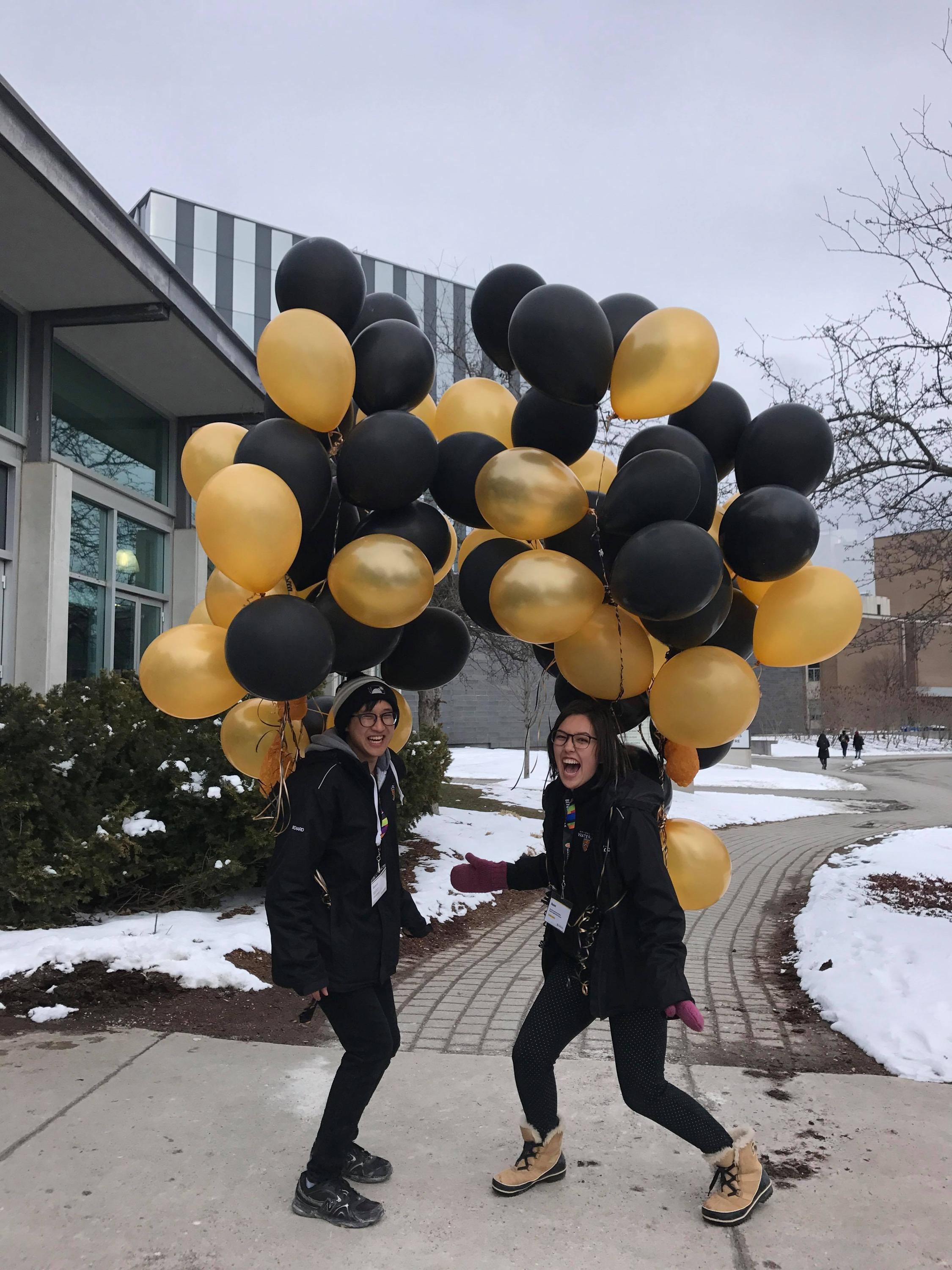 Richard Nguyen and a colleague with balloons