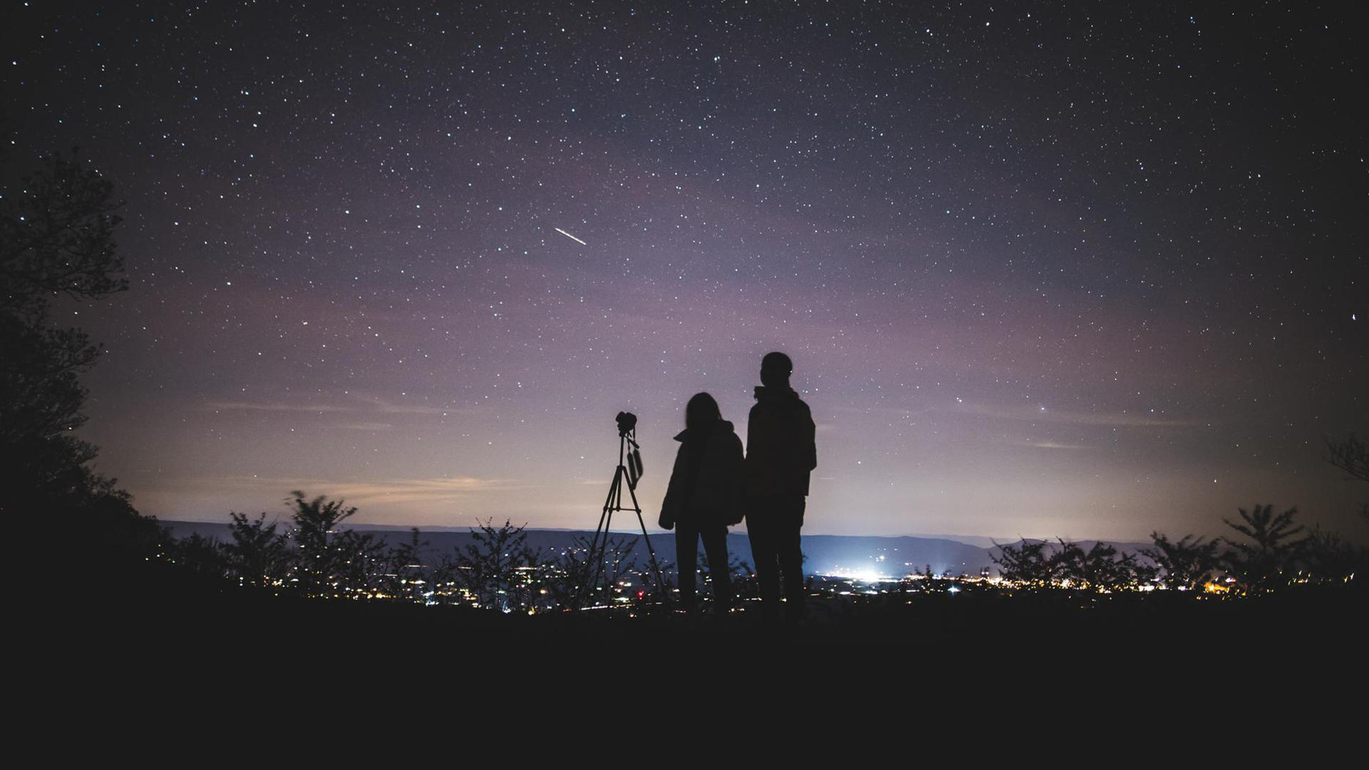 Night sky and people silhouette