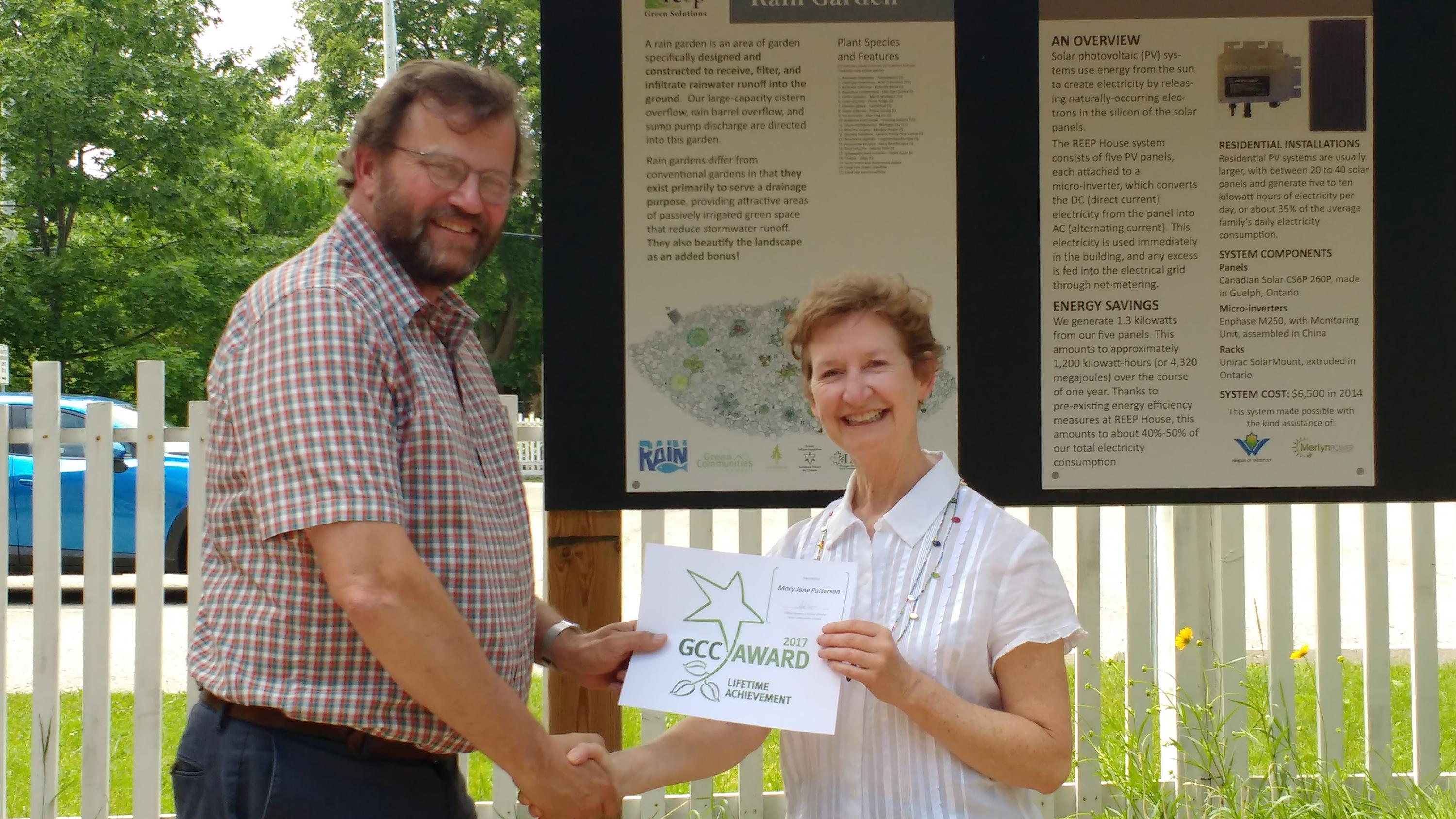 Mary Jan recieving an award for making the community greener