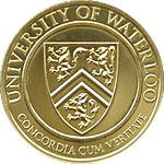 Alumni gold medal with University of Waterloo crest on it