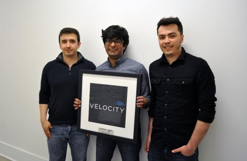 Lumotune team holding a velocity picture