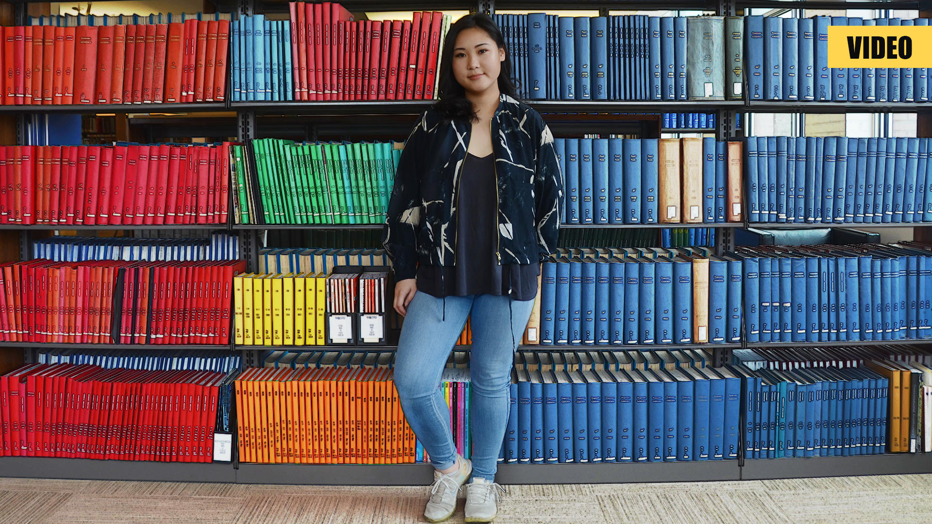 Kathleen in front of library books