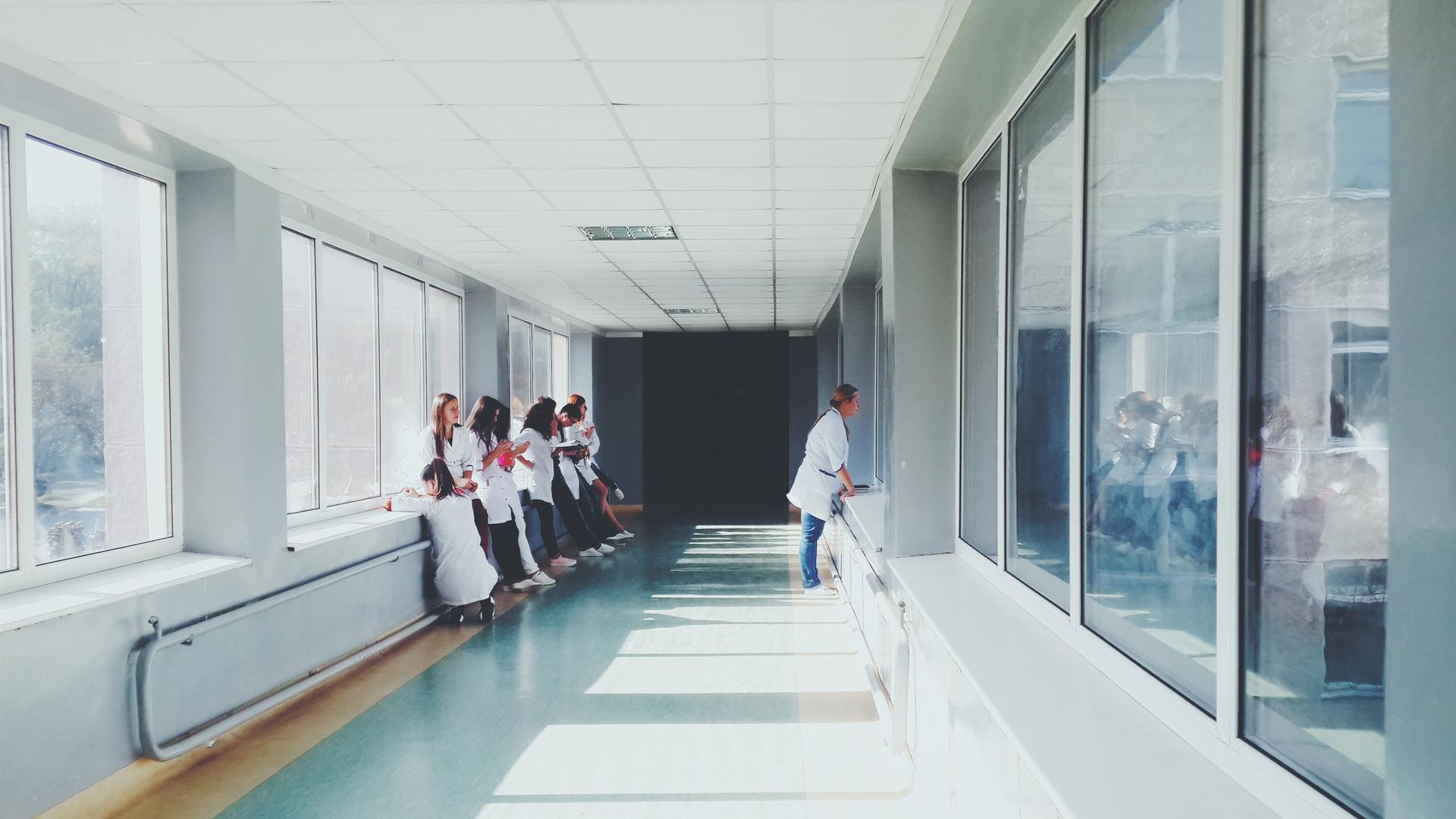 Hospital workers in a hallway