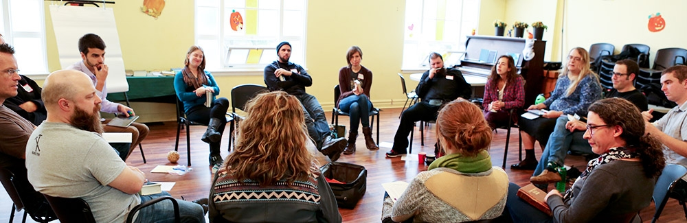Workshop participants sitting in a circle.