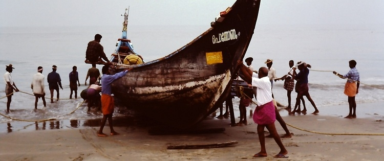 fishermen with boat on the Malabar coastline