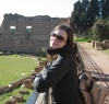 Stacy Reda in front of Roman ruins