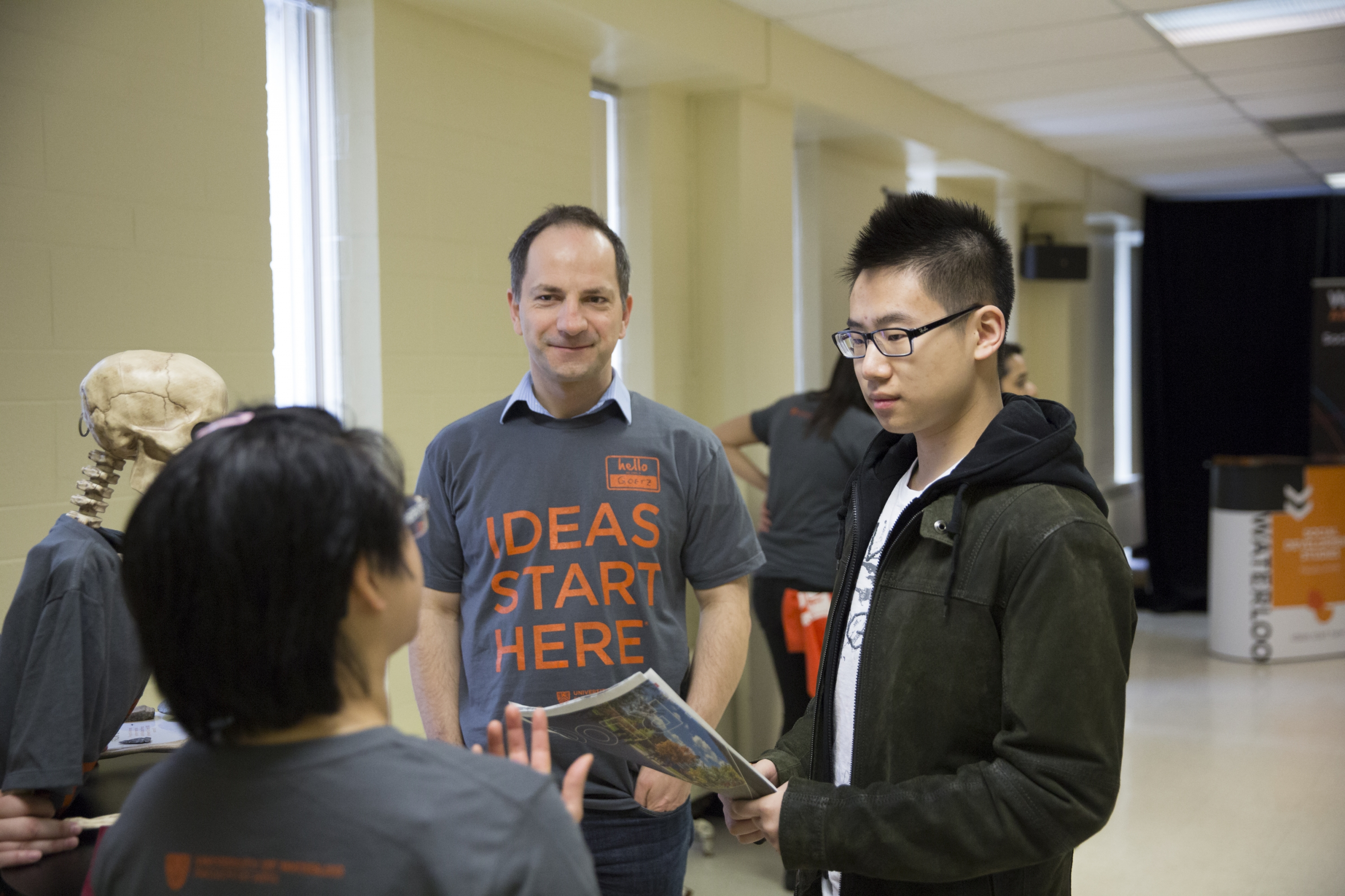 Dr. Götz Hoeppe and current student talking to prospective student