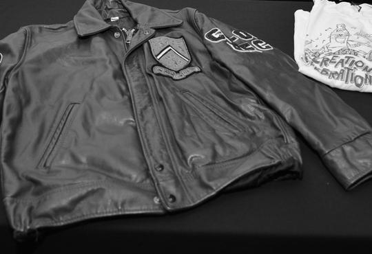 Leather UWaterloo school jacket and orientation shirt.