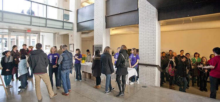 People in atrium at previous Open House