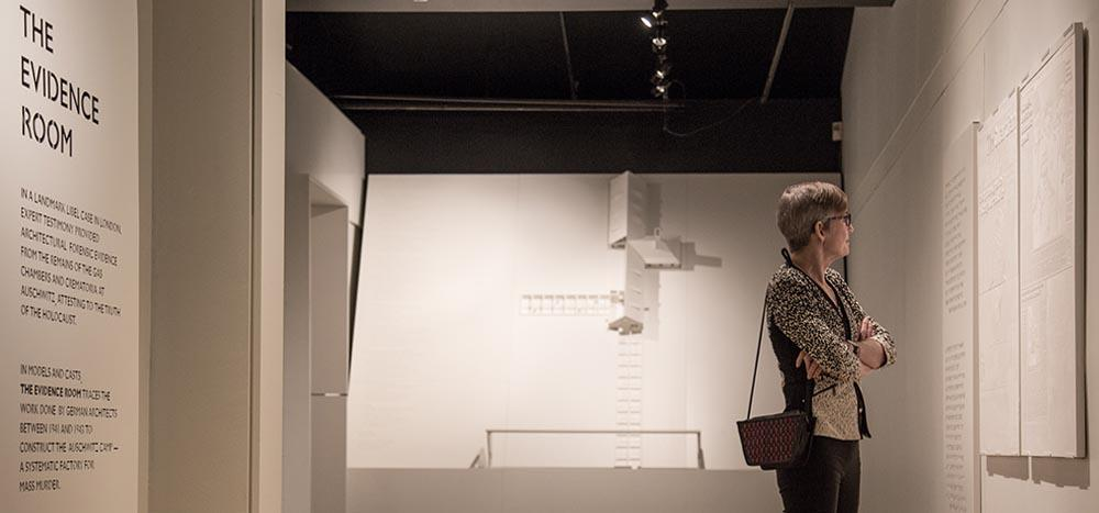 person examining the Evidence Room plans