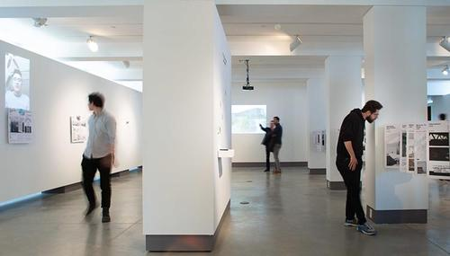 several people in white gallery space