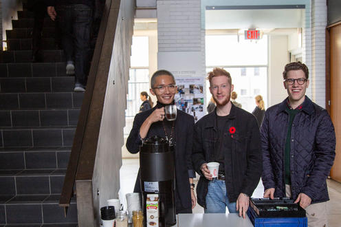 Students at Open House Offering Coffee and Q&A