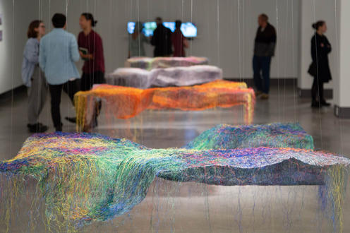 Coloured paper formed over rocks in the design at Riverside Gallery
