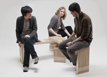 3 students sitting on chair project