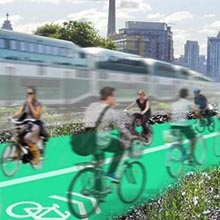 Rendering of cyclists beside mass transit