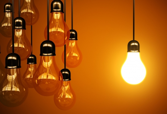Suspended lightbulbs with one lit