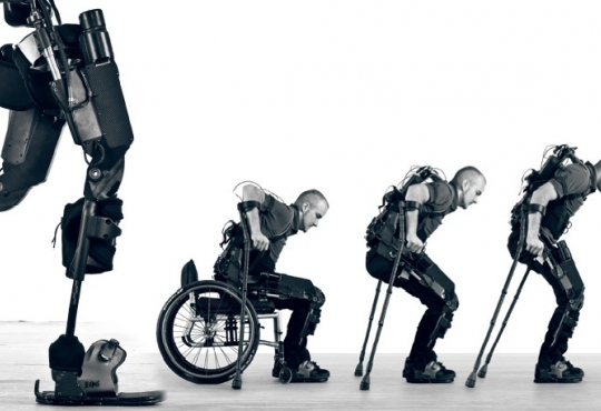 Man transitioning from wheelchair to bionic legs