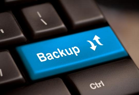 A backspace key that says backup