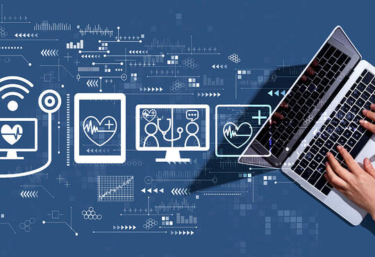 computer with lines connecting to medical related icons