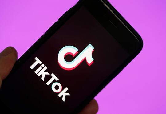 Tiktok displayed on cell phone