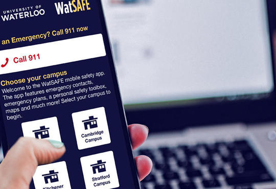 Picture of hand holding phone with WatSAFE app