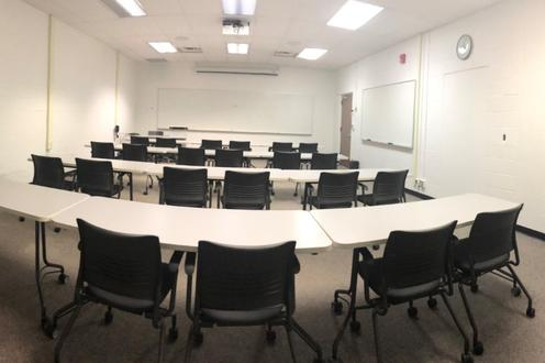 Desks and chairs in the ML-109 Language Lab.