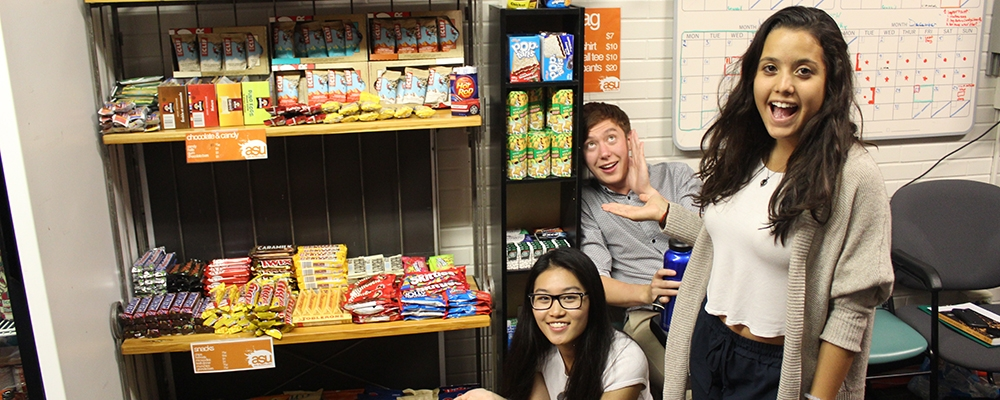 Students standing around snacks at the ASU Tuck Shop