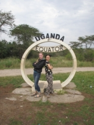 Two girls infront of the Ugand Equator sign