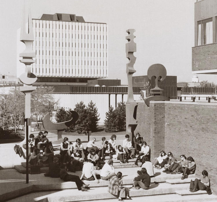 Archival photo of Waterloo campus with students in the 1970s