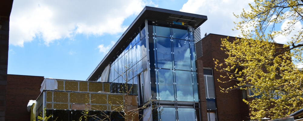 tall glass window frontage of new building atrium