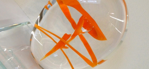 glass sculpture with orange swirl