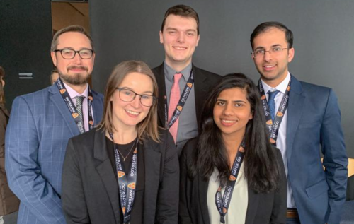 five-member Datafest grad student team smile in group pose