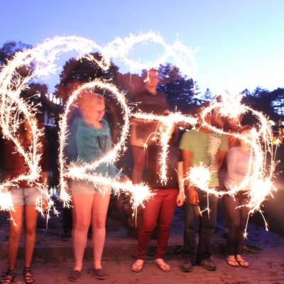 "Students making the word ""Arts"" with sparklers."