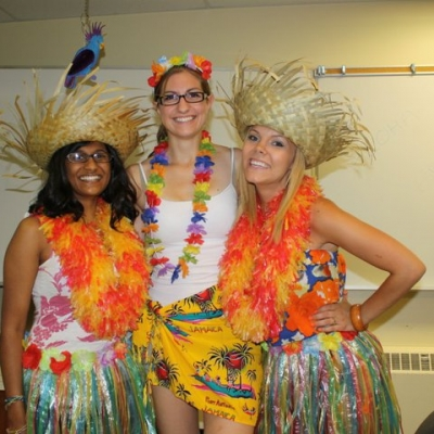 Three students dressed up in Hawaiin themeffor Arts Orientation.
