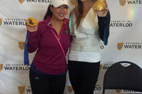 Two girls showing their medals from the fun run
