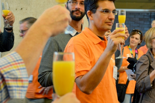 People toasting with orange juice