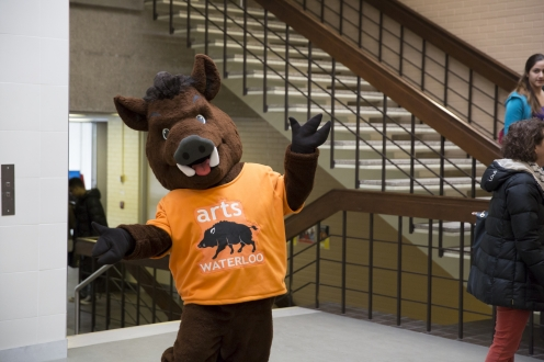 Porcellino mascot posing in Arts Lecture Hall.